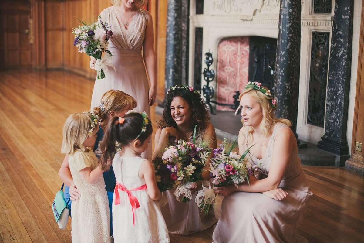 Bridesmaids and flower girls in flower crowns at wedding in Oxford Town Hall