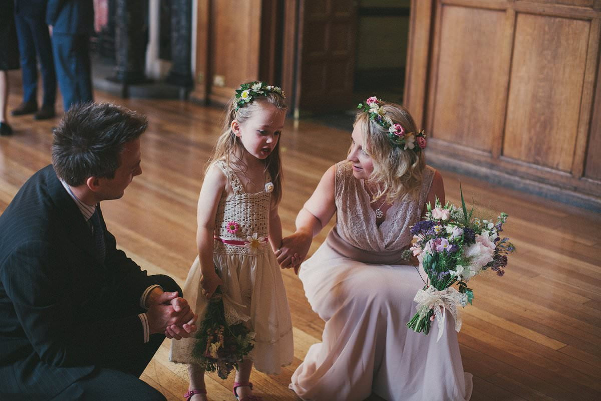 Bridesmaid and flower girl in flower crowns at wedding in Oxford Town Hall