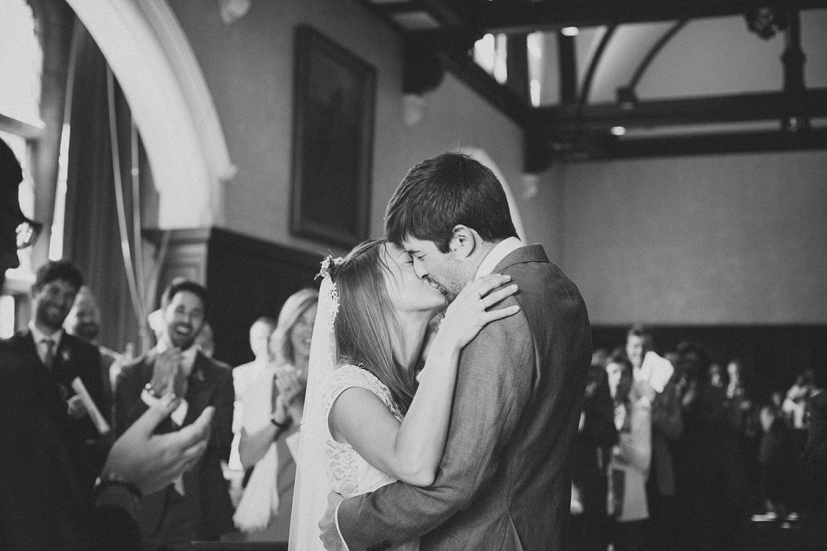 Bride and groom kissing after being married at Oxford Town Hall
