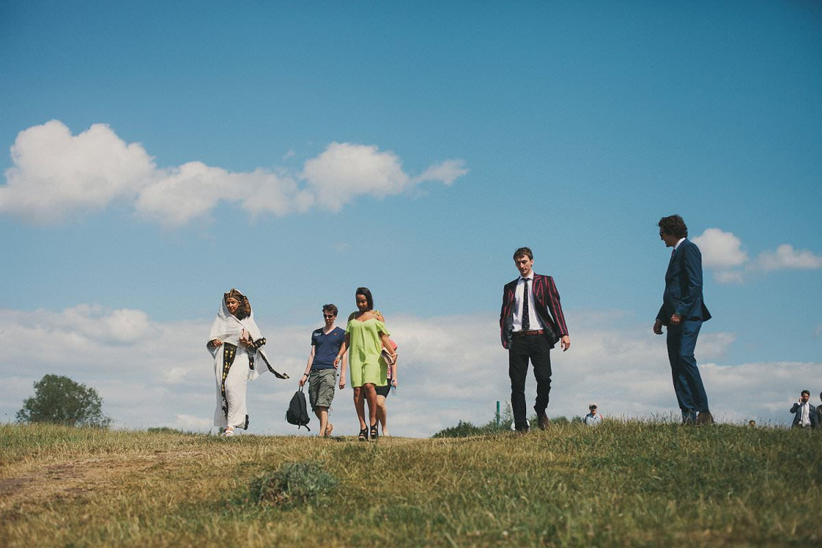 Wedding guests walking to Port Meadow in Oxford