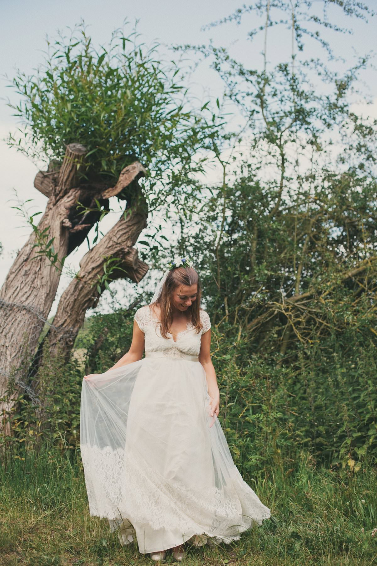 Bride in Claire Pettibone dress sways dress during wedding in Port Meadow Oxford