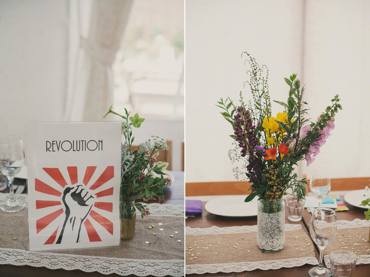 DIY wildflowers and Revolution activist table name at wedding in The Perch Oxford