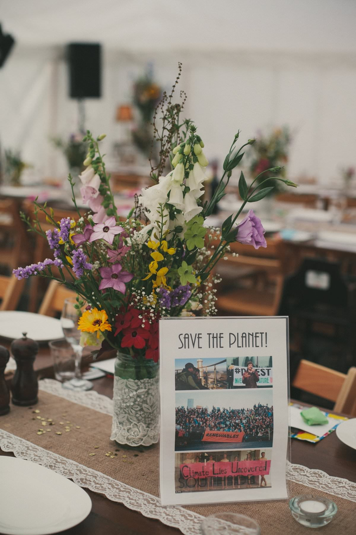 Wildflowers and Save The Planet activist table name at wedding in the Perch Oxford