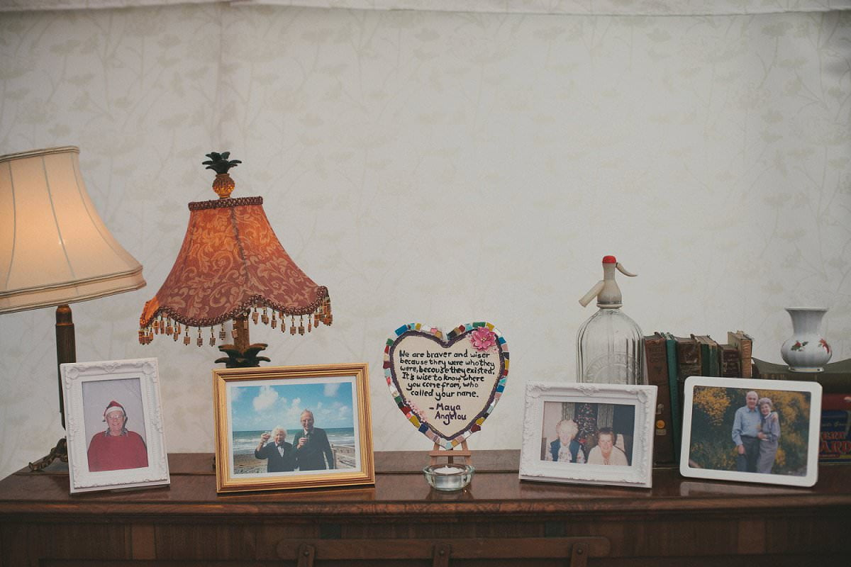 Framed family photos and DIY tile with poem at wedding in the Perch Oxford