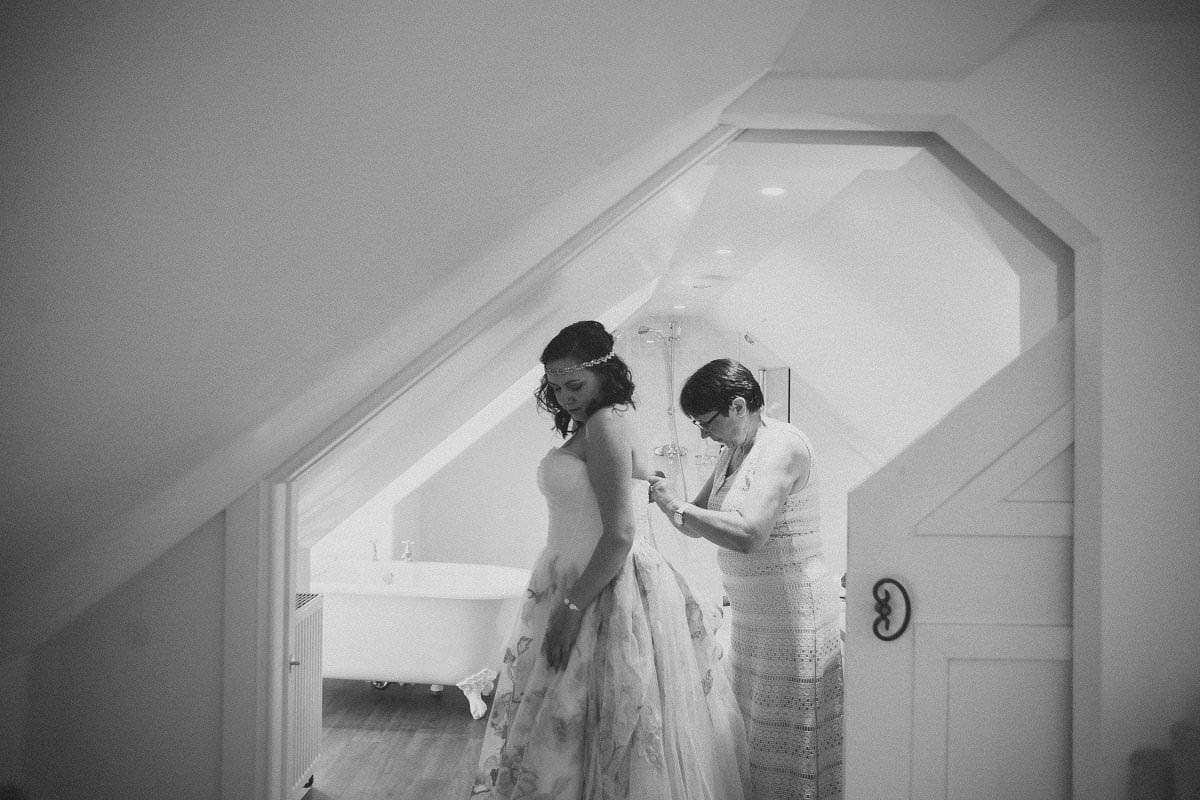Bride gets dress done up by mother for wedding elopement at Glenisle Hotel on The Isle of Arran Scotland