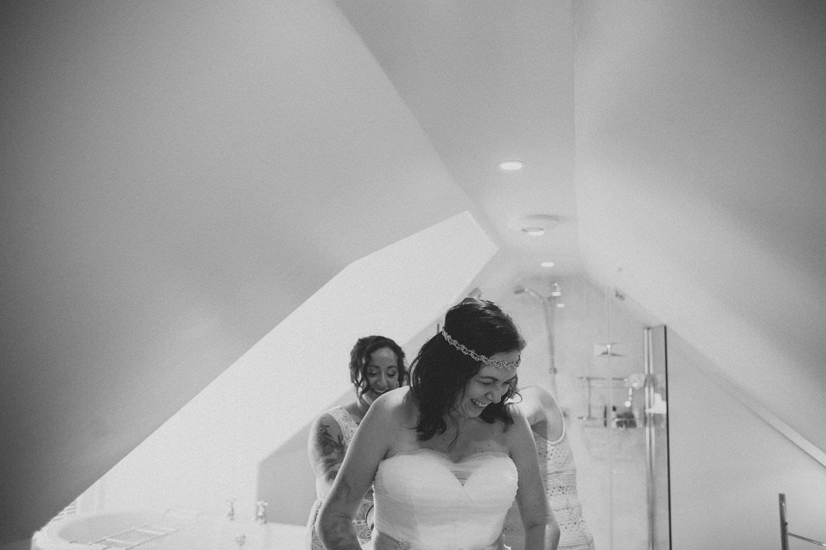 Bride laughs while getting ready at wedding elopement at Glenisle Hotel on The Isle of Arran Scotland