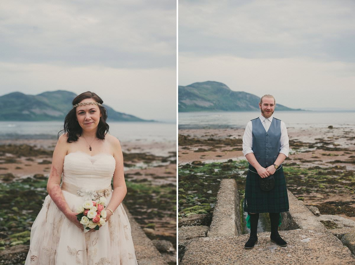 Bride and groom stand sea during first look at wedding elopement outside Glenisle Hotel on The Isle of Arran Scotland