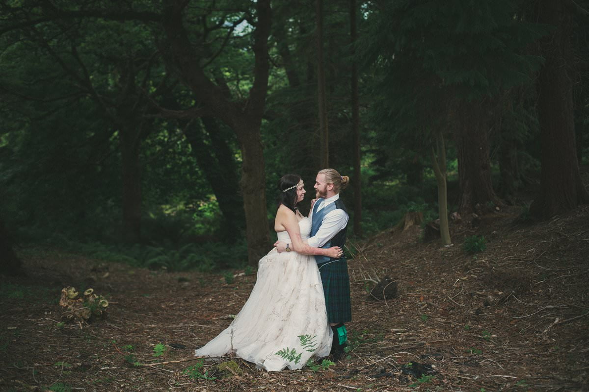 Bride and groom in Brodick Castle gardens on The Isle of Arran Scotland during elopement wedding