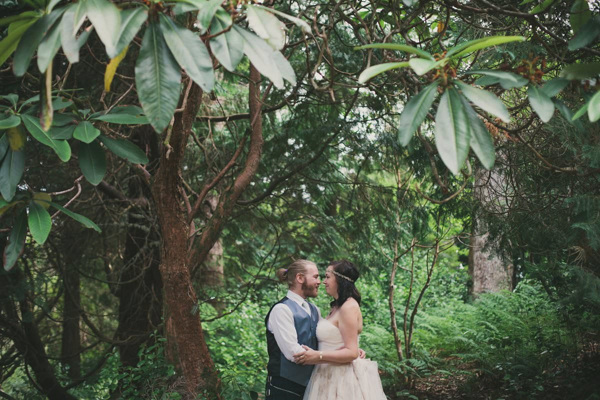 Bride and groom under tree in Brodick Castle The Isle of Arran Scotland during elopement wedding