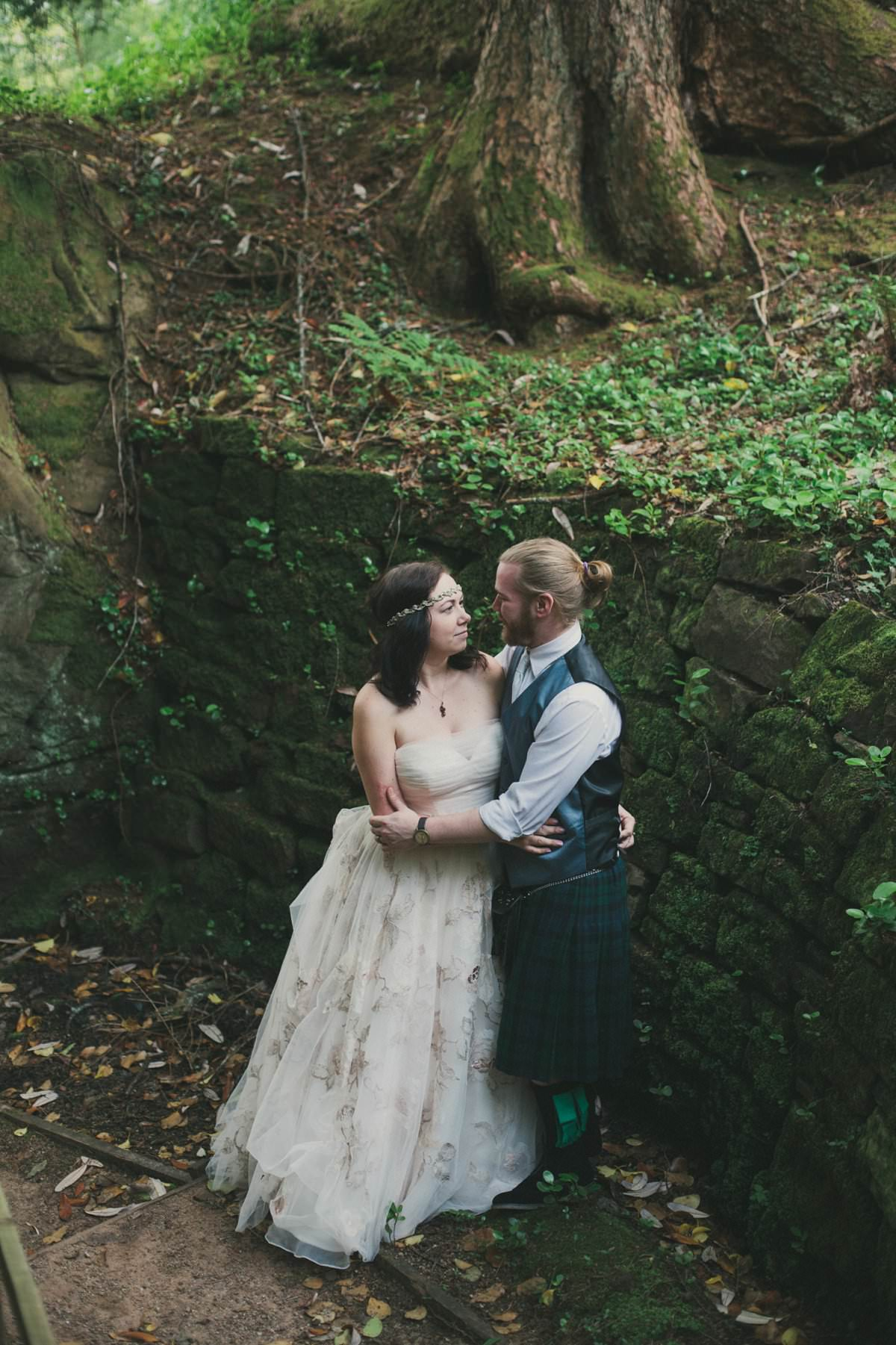 Bride and groom looking at eachother in grounds of Brodick Castle The Isle of Arran Scotland during elopement wedding