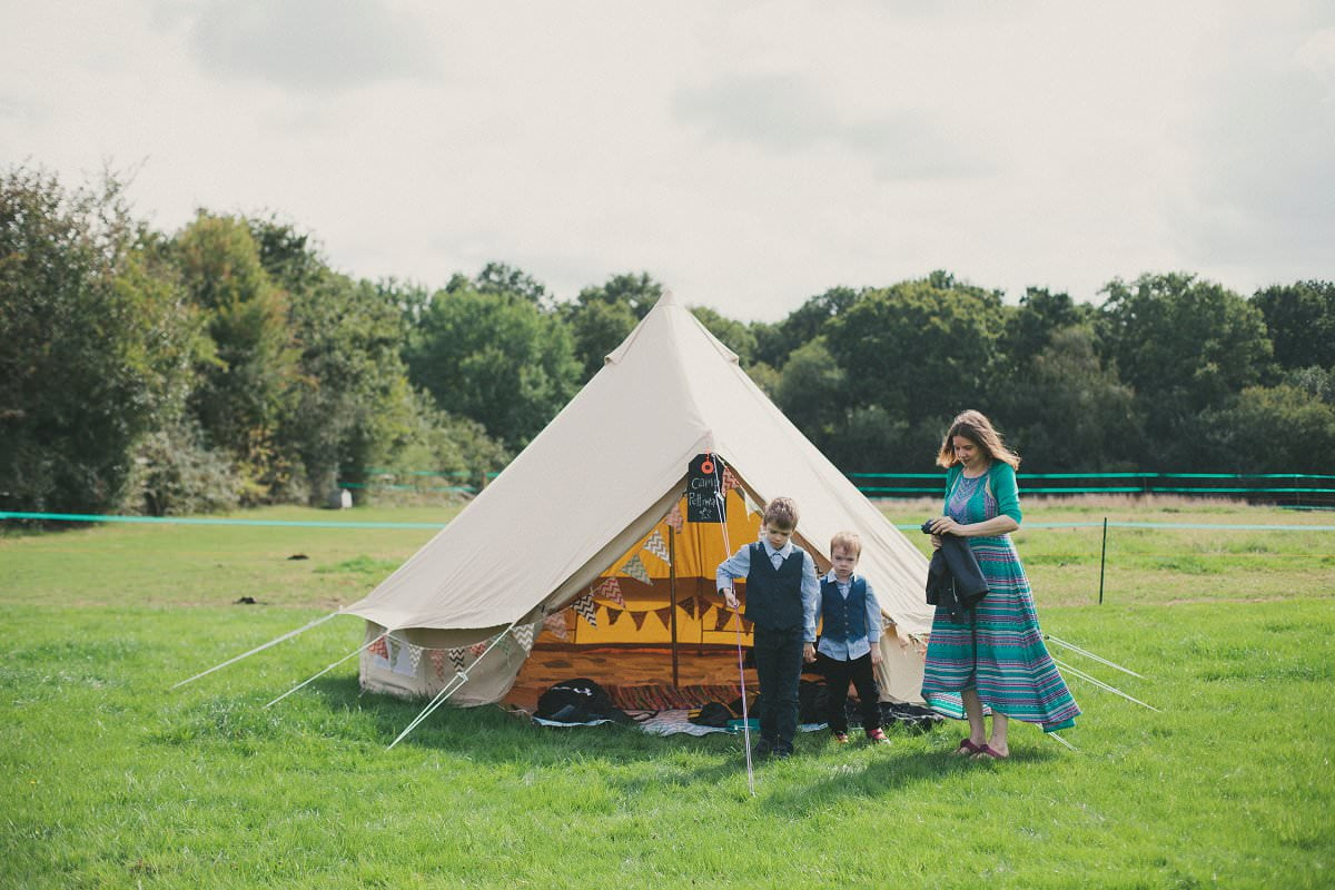 Children by their tipi at festival wedding