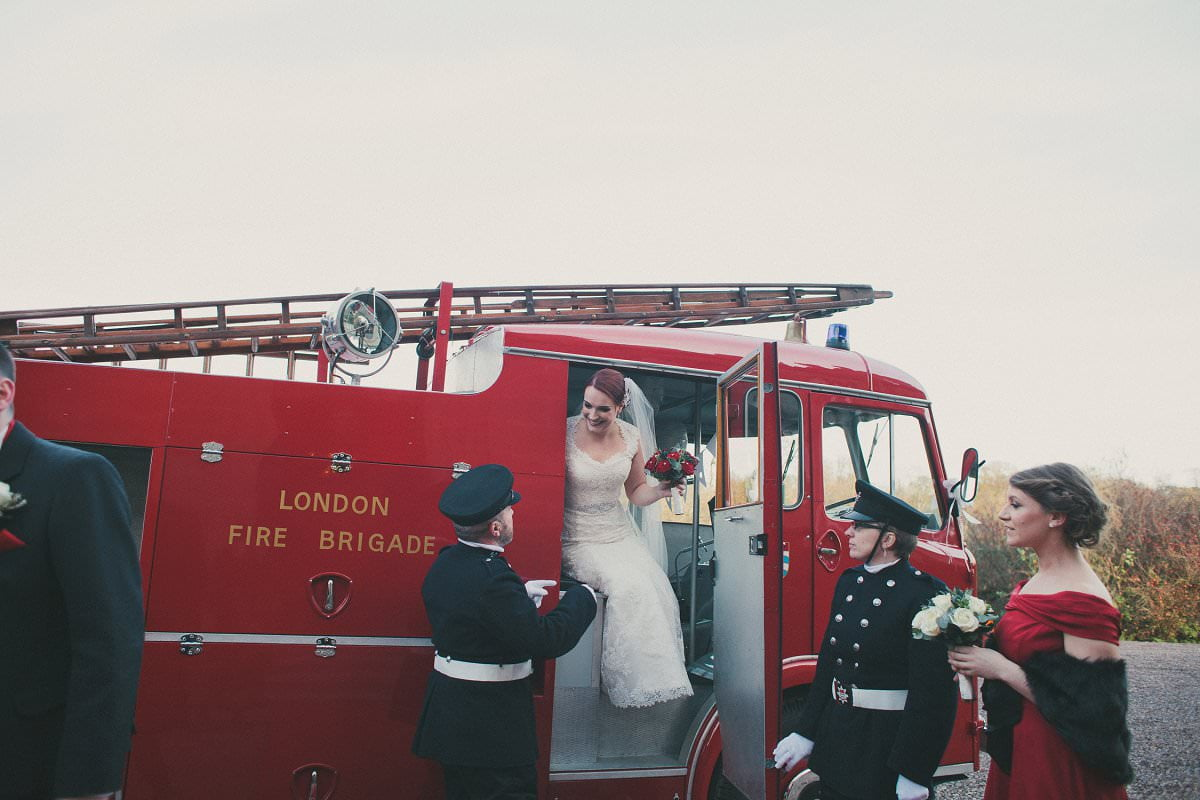 bride arriving in fire engine oxenfoord castle wedding photography