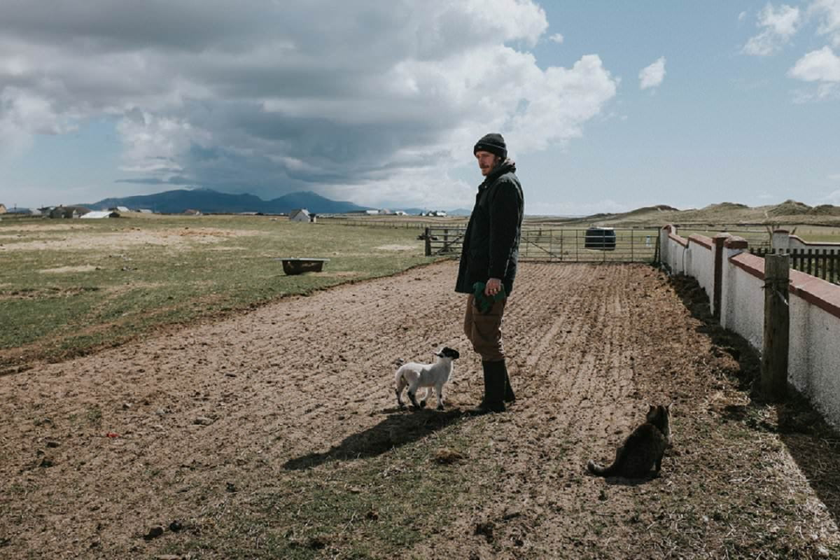 crofter with lamb and cat benbecula