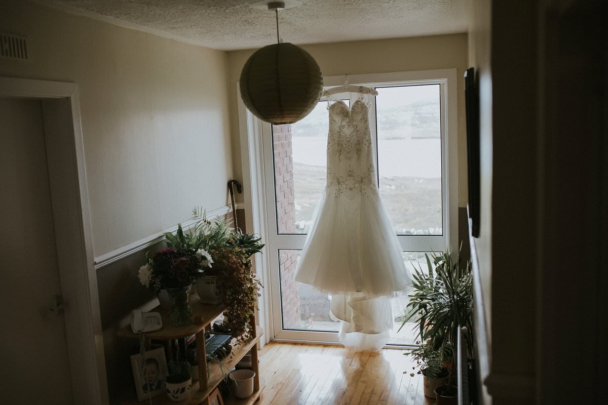 bride wedding dress hanging at home scotland