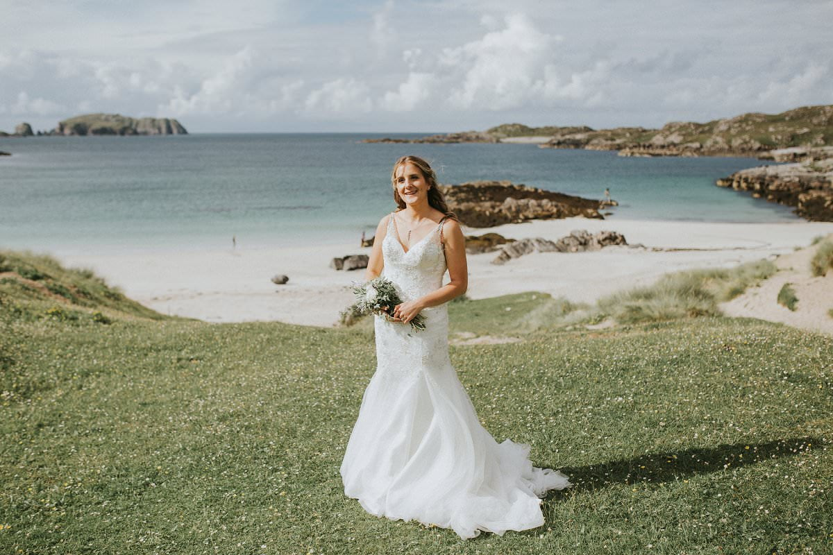 cliff edge beach wedding bride