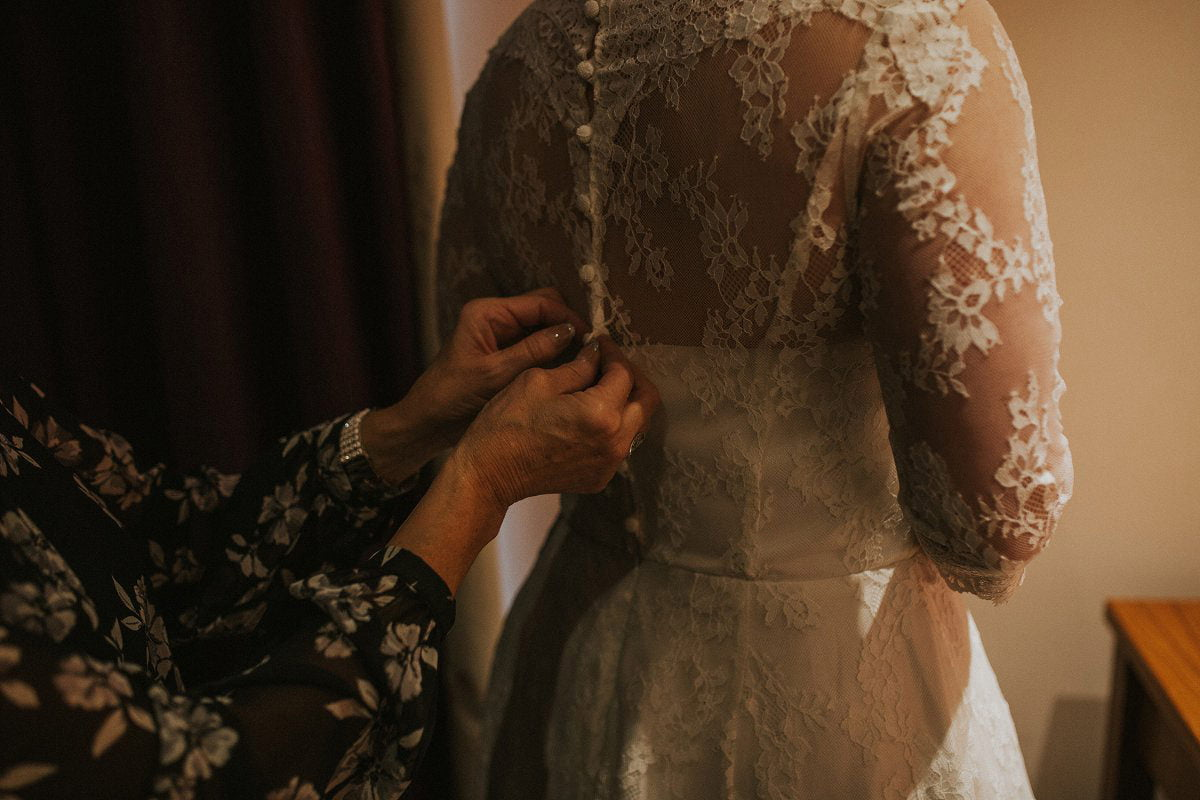 bride getting ready vintage lace wedding dress