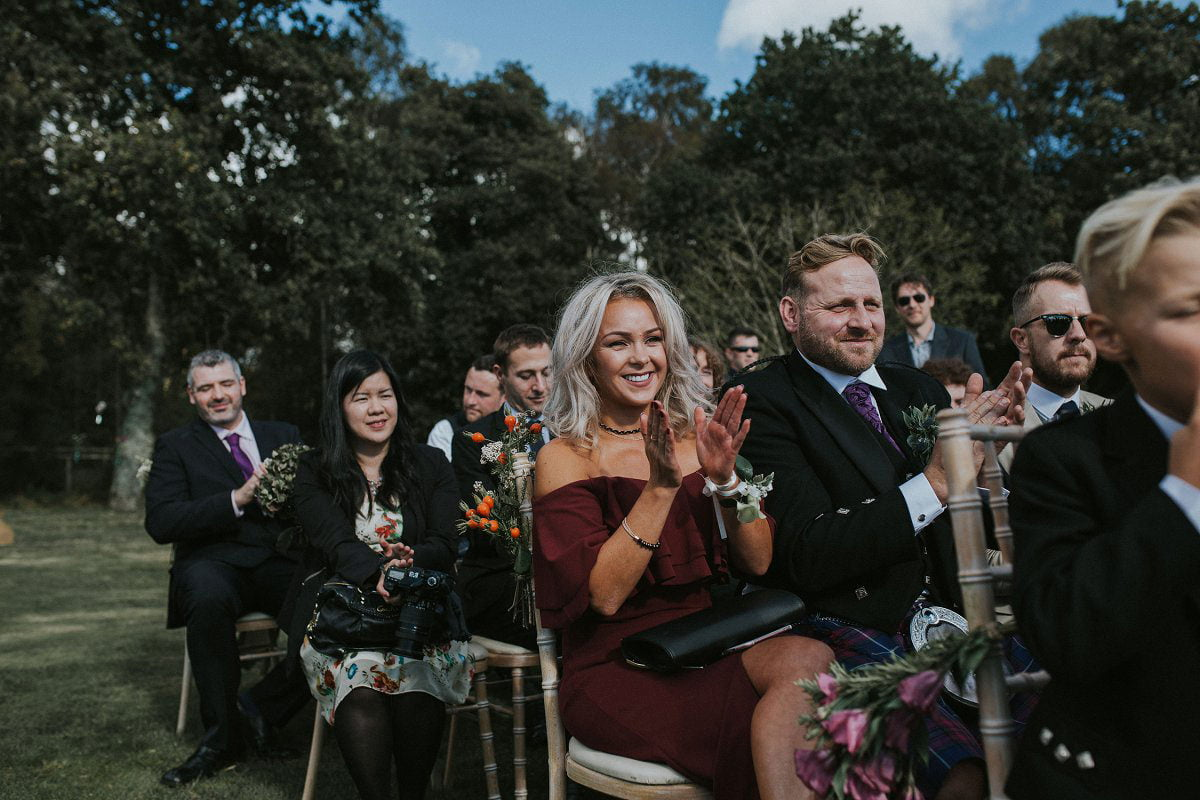guests clapping wedding outdoor