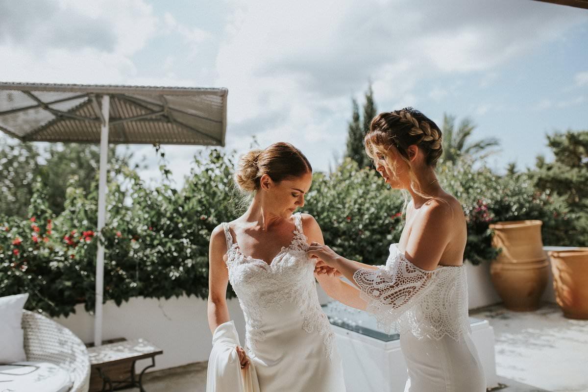 ibiza bride getting into dress