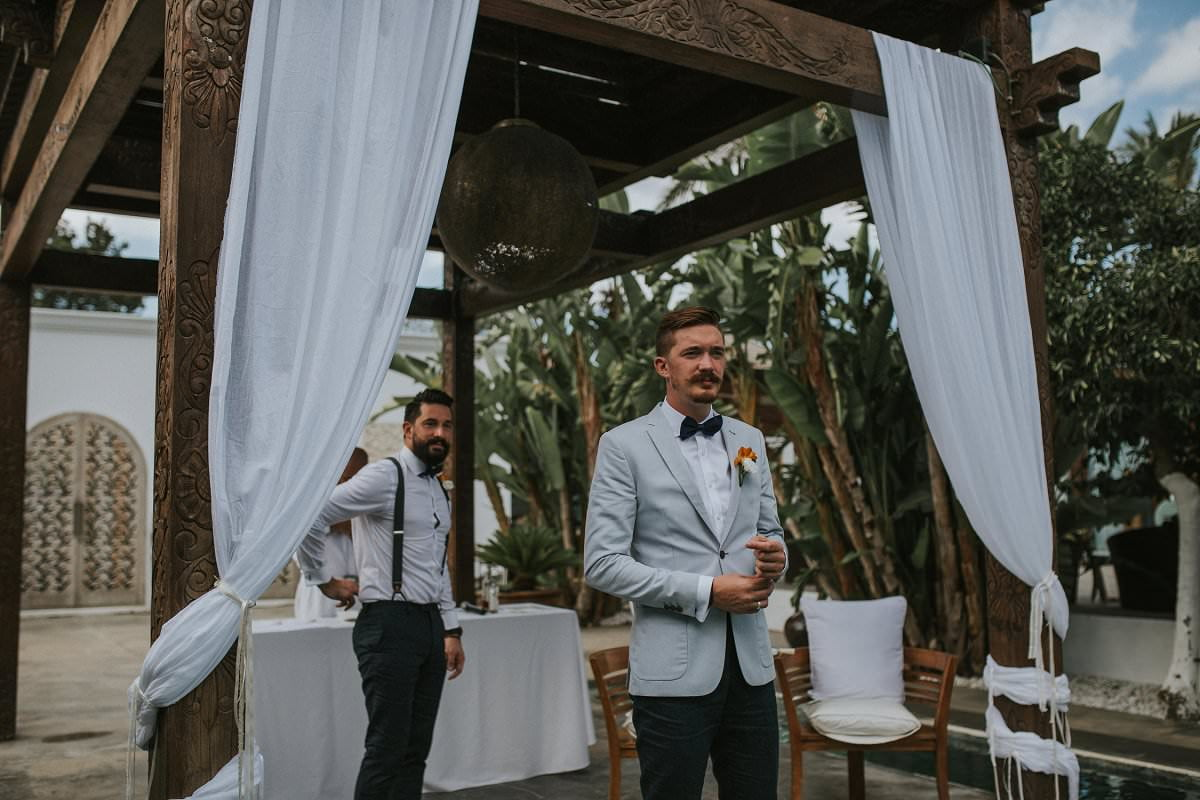 hipster groom waiting ceremony