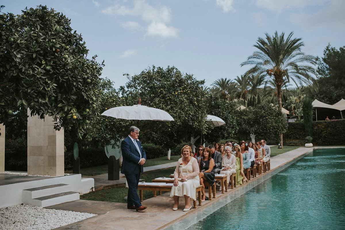 atzaro wedding ceremony guests by pool