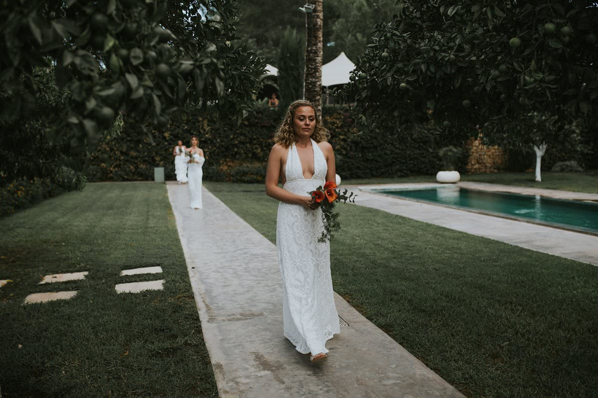 crying bridesmaid in white dress walking aisle