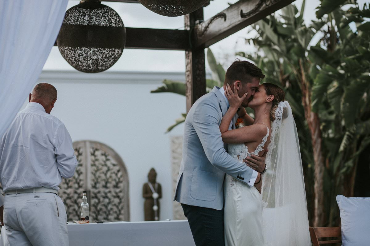bride groom kiss wedding ceremony