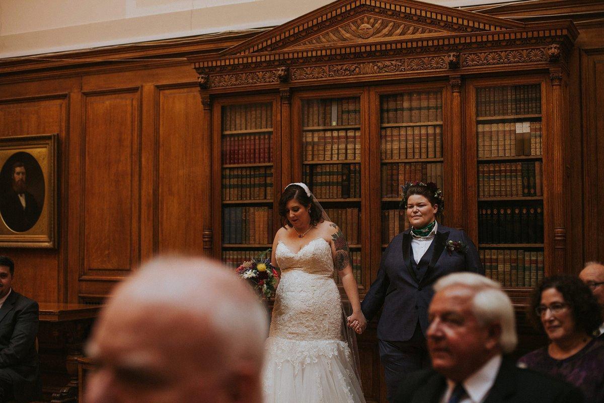 couple walking aisle together wedding